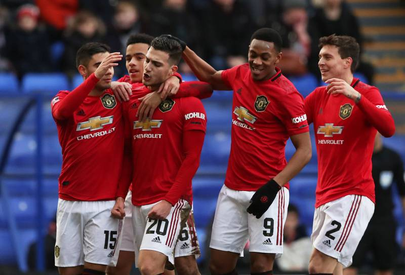 Soccer Football -  FA Cup Fourth Round - Tranmere Rovers v Manchester United - Prenton Park, Birkenhead, Britain - January 26, 2020  Manchester United's Diogo Dalot celebrates scoring their second goal with teammates      REUTERS/Scott Heppell