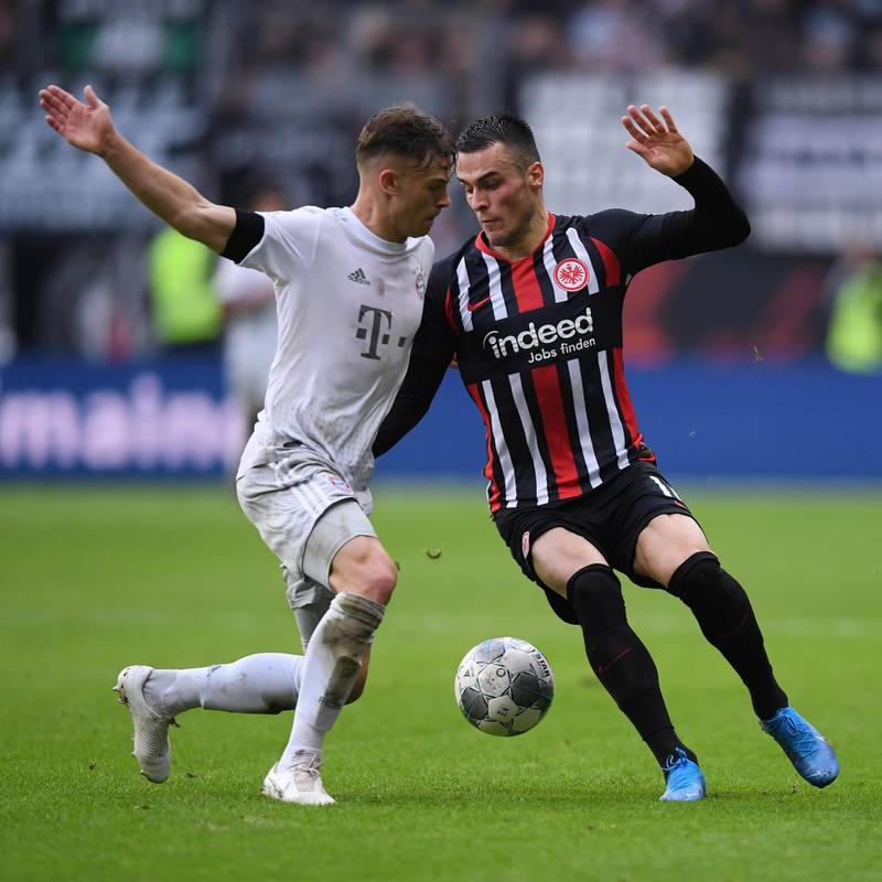 FRANKFURT AM MAIN, GERMANY - NOVEMBER 02: Joshua Kimmich of Muenchen is challenged by Filip Kostic of Frankfurt during the Bundesliga match between Eintracht Frankfurt and FC Bayern Muenchen at Commerzbank-Arena on November 02, 2019 in Frankfurt am Main, Germany. (Photo by Alex Grimm/Bongarts/Getty Images)