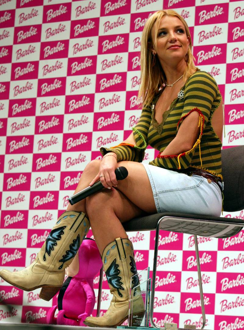 404271 04: Pop singer Britney Spears sits onstage at a Barbie Award ceremony April 21, 2002 in Tokyo, Japan. Spears was presented with the Barbie award, which was created by U.S. toy maker Mattle Inc. and Japans toy maker Bandai Co. in 2001. The award is presented to a woman who ''''realizes her dream'''' like the dress-up doll Barbie. (Photo by Koichi Kamoshida/Getty Images)