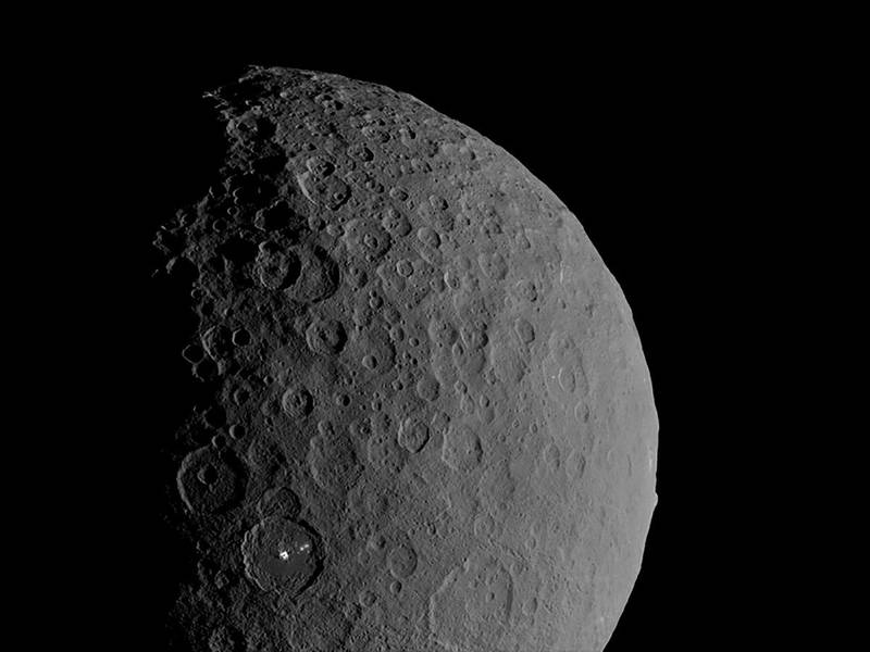Occator Crater and Ahuna Mons appear together in this view of the dwarf planet Ceres obtained by NASA's Dawn spacecraft on February 11, 2017. NASA/JPL-Caltech/UCLA/MPS/DLR/IDA/Handout via REUTERS.  THIS IMAGE HAS BEEN SUPPLIED BY A THIRD PARTY.