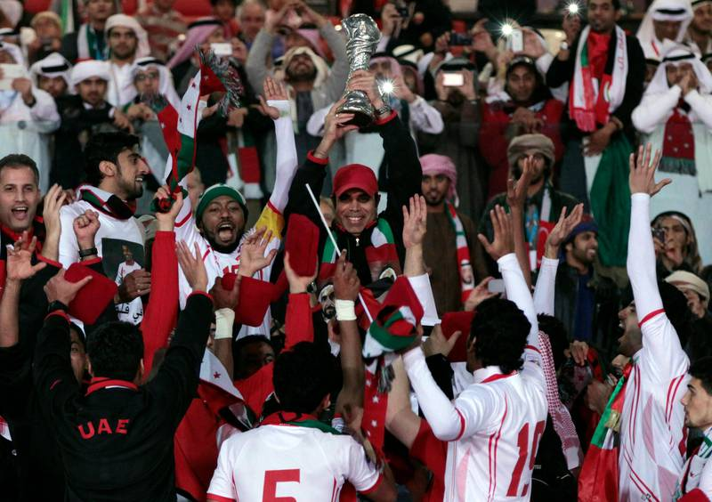 United Arab Emirates team celebrate at the end of their match against Iraq in the Gulf Cup final Friday, Jan. 18 , 2013, in Rifa, Bahrain. United Arab Emirates beat Iraq 2-1 in extra time on Friday to claim its second Gulf Cup title. (AP Photo/Hasan Jamali) *** Local Caption ***  Bahrain Gulf Cup.JPEG-08564.jpg
