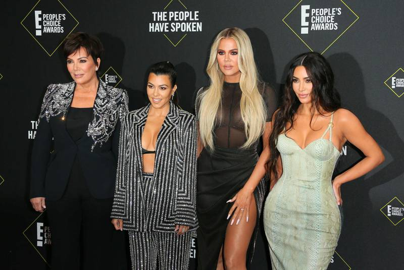 """(FILES) In this file photo taken on November 10, 2019 (L-R) Business women/media personality Kris Jenner, Kourtney Kardashian, Khloé Kardashian and Kim Kardashian arrive for the 45th annual E! People's Choice Awards at Barker Hangar in Santa Monica, California. Fans will have to find another way to keep up with the Kardashians, as the mega-celebrity family announced on September 8, 2020 that their reality show will end next year. """"It is with heavy hearts that we've made the difficult decision as a family to say goodbye to Keeping Up with the Kardashians,"""" Kim Kardashian wrote in a post to her 188 million Instagram followers. / AFP / Jean-Baptiste Lacroix"""
