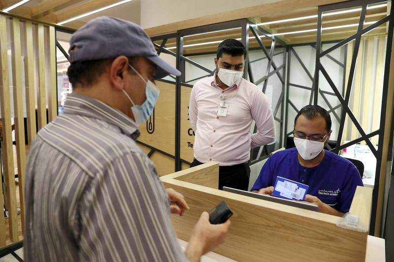 DUBAI, UNITED ARAB EMIRATES , October 14 – 2020 :- People taking their token for the COVID-19 nasal swab test at the COVID 19 testing station set up at Mall of the Emirates in Dubai. (Pawan Singh / The National) For News/Online. Story by Sarwat
