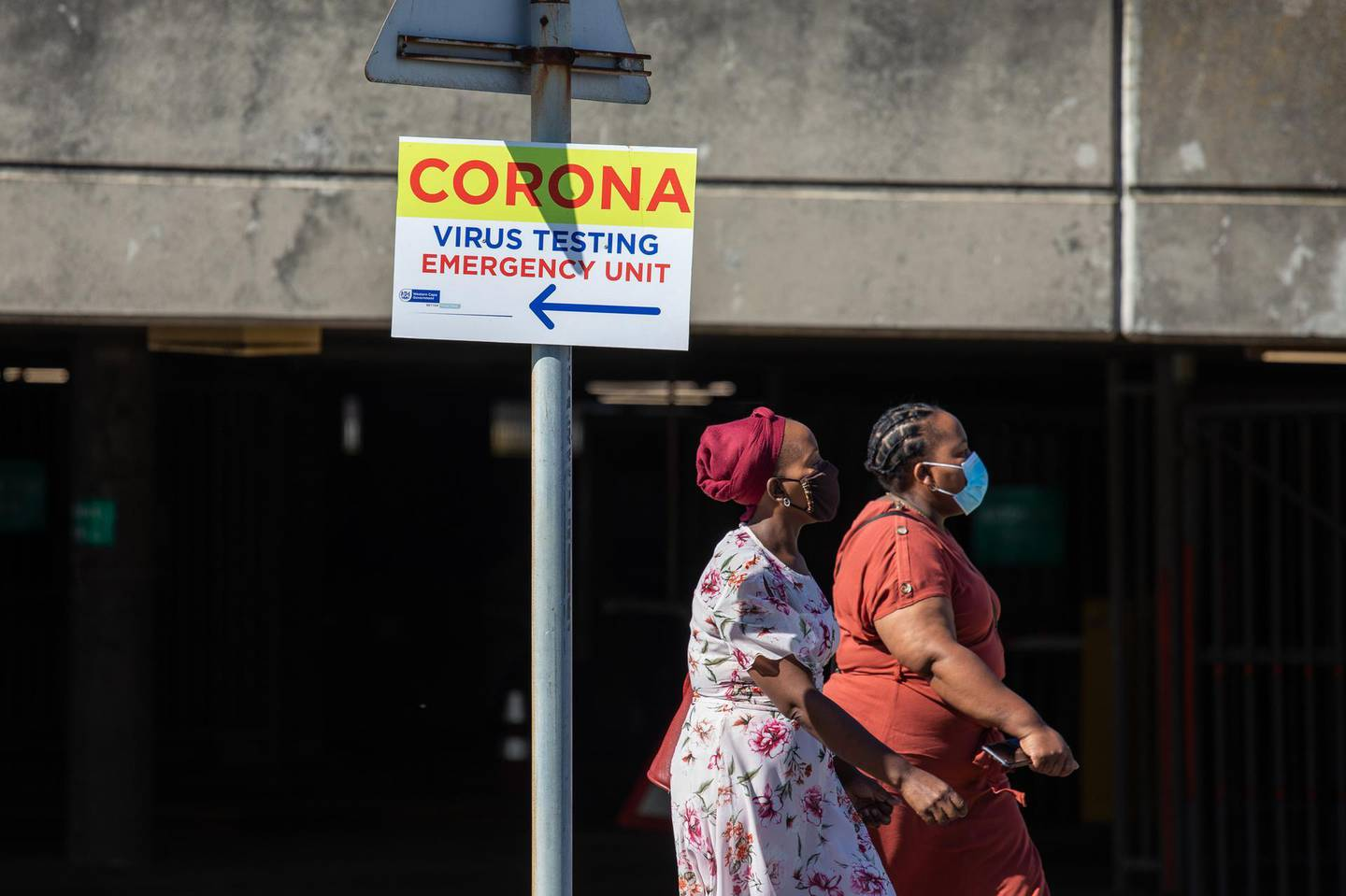 A coronavirus testing unit sign outside Groote Schuur hospital in Cape Town, South Africa, on Monday, Jan. 11, 2021. The pandemic and restrictions imposed to contain it have devastated Africa's most industrialized economy, and the extension of curbs that came into effect at the height of the holiday season bode ill for efforts to engineer arebound. Photographer: Dwayne Senior/Bloomberg