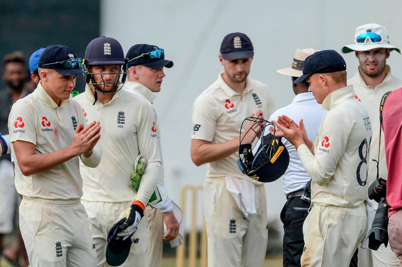 England's cricketers leave the ground after the second day of a four-day practice match between Sri Lanka Board President's XI and England at the P. Sara Oval Cricket Stadium in Colombo on March 13, 2020. England's cricket team abruptly pulled out of a tour of Sri Lanka on March 13 over the mounting coronavirus pandemic. A practice match in Colombo was halted as the team announced they would be flying back to London, and the first of two Test matches due to start on March 19 has been postponed. / AFP / LAKRUWAN WANNIARACHCHI