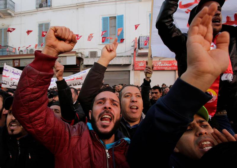 Men shout slogans during demonstrations on the seventh anniversary of the toppling of president Zine El-Abidine Ben Ali, in Tunis, Tunisia January 14, 2018. REUTERS/Youssef Boudlal