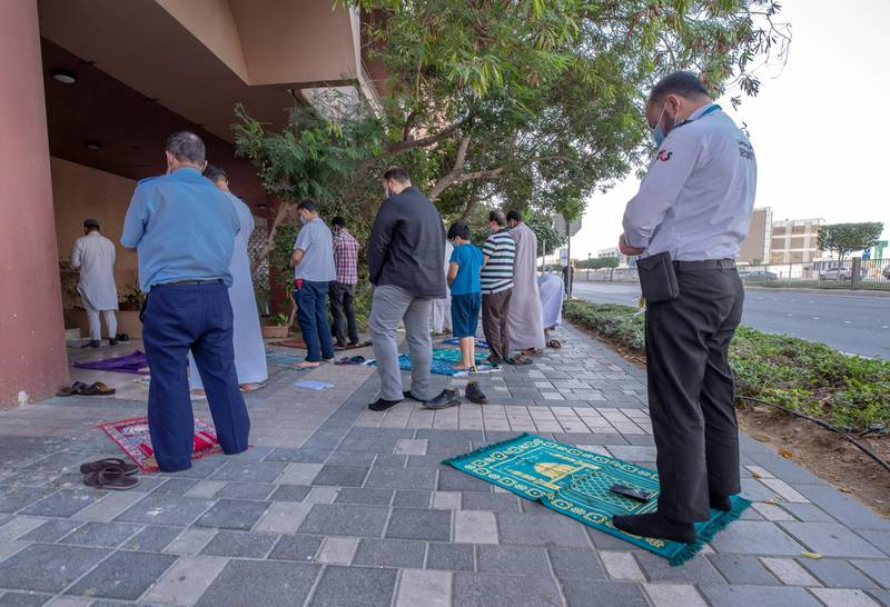 Worshippers during Asr gather outside an already full private Mosque in Zadco Building along Al Khaleej Al Arabi Street in central Abu Dhabi on April 26th, 2021. Victor Besa / The National.