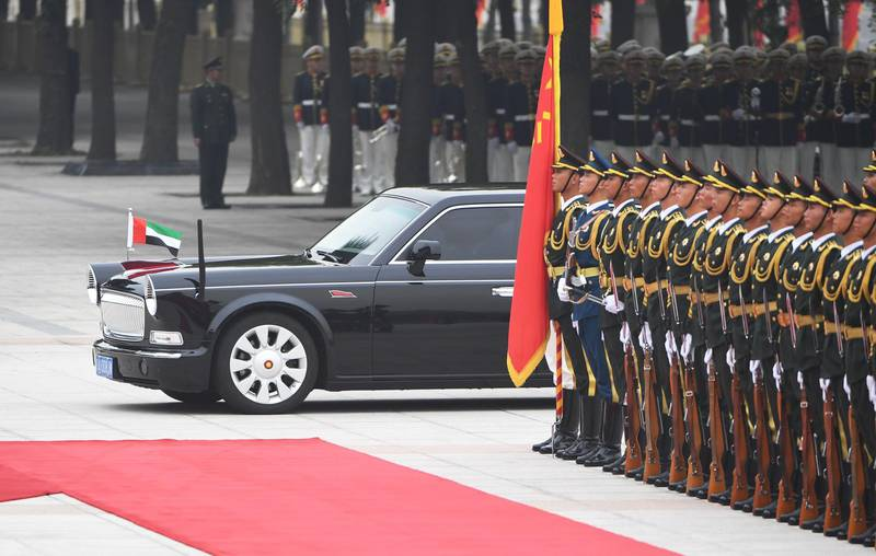 The Red Flag limousine carrying Abu Dhabi Crown Prince Mohammed bin Zayed passes a military honour guard as he arrives for a welcoming ceremony outside the Great Hall of the People in Beijing on July 22, 2019. / AFP / GREG BAKER