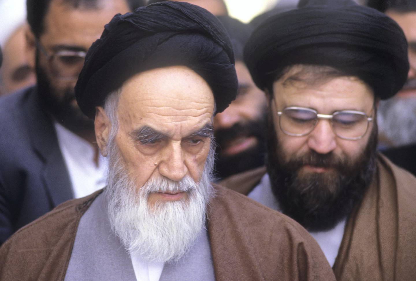 Tehran, Iran: Ayatollah Ruhollah Khomeini (L) the leader and founder of Islamic Republic of Iran, looking frail votes for parliament election, in his residence Jamaran, in north Tehran 8th April 1988. His son Ahmad (R) stands next to him. (Photo by Kaveh Kazemi/Getty Images)