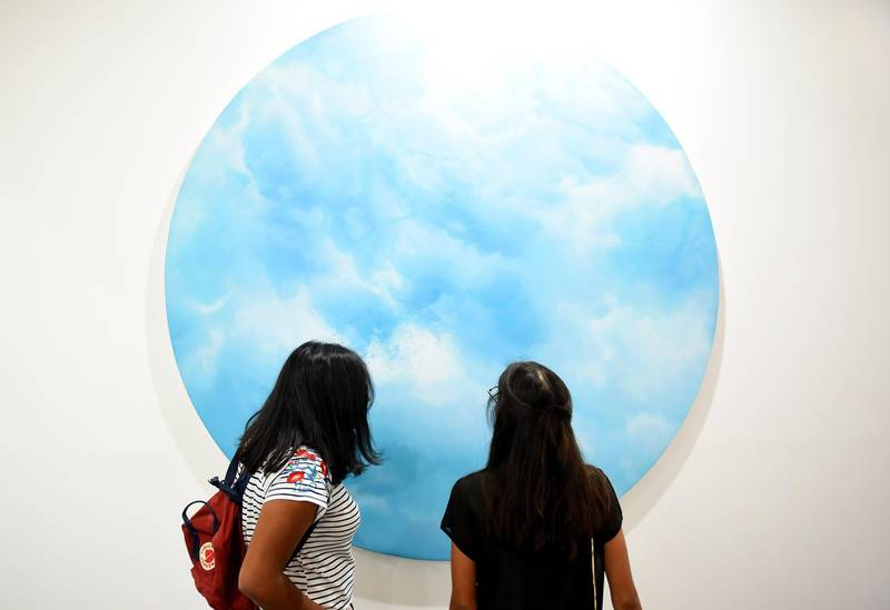 DUBAI, UNITED ARAB EMIRATES - MARCH 22:  Visitors attend Art Dubai on March 22, 2018 in Dubai, United Arab Emirates.  (Photo by Tom Dulat/Getty Images)