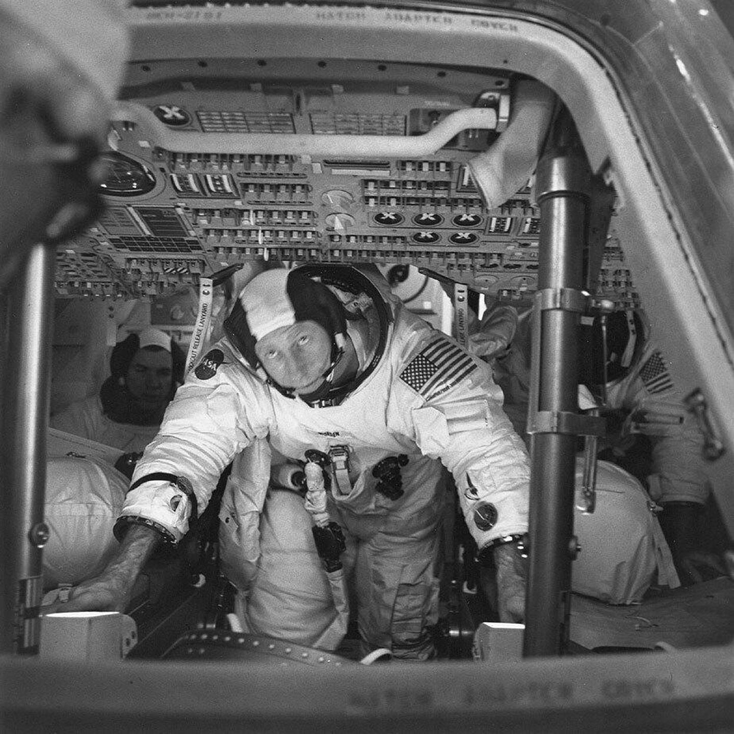 This March 26, 1971 photo made available by NASA shows astronauts Al Worden, center, Dave Scott, left, and Jim Irwin in the Command Module for an altitude chamber test at Cape Canaveral, Fla. Worden, who circled the moon alone in 1971 while his two crewmates tried out the first lunar rover, has died at age 88, his family said Wednesday, March 18, 2020. (NASA via AP)