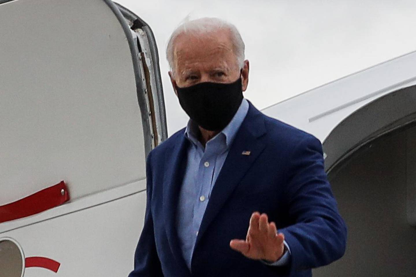 Democratic U.S. presidential nominee Joe Biden disembarks from his campaign plane as he arrives for his first presidential debate with U.S. President Donald Trump at Cleveland Hopkins International Airport in Cleveland, Ohio, U.S., September 29, 2020. REUTERS/Mike Segar