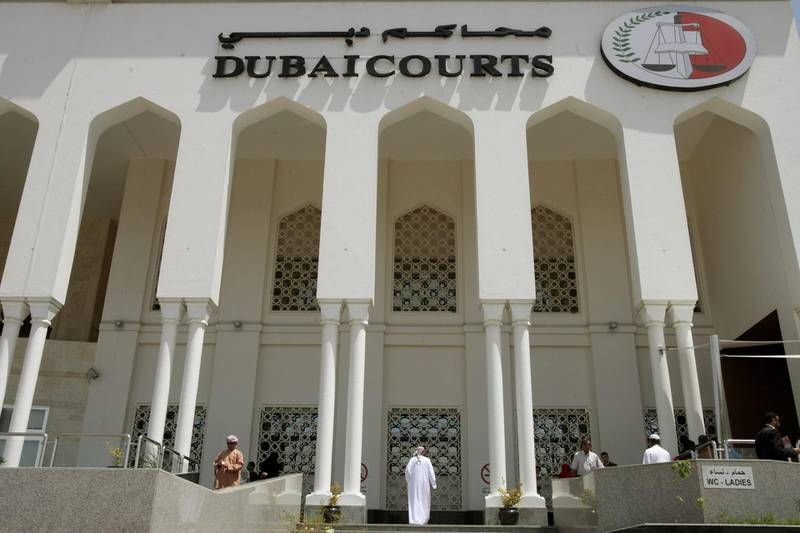 A closeup shot shows the facade of the Dubai Courts building during a hearing on April 04, 2010 in the case of a British couple sentenced to a month in jail after being convicted of kissing in public in a restaurant in the Muslim Gulf emirate. The couple's lawyer said the appeals court upheld the one-month prison sentence against the two, named by the British press as Ayman Najafi, 24, a British expat, and tourist Charlotte Lewis, 25. The couple were arrested in November 2009, after they were accused of consuming alcohol and kissing in a restaurant in the trendy Jumeirah Beach Residence neighbourhood.     AFP PHOTO/STR / AFP PHOTO