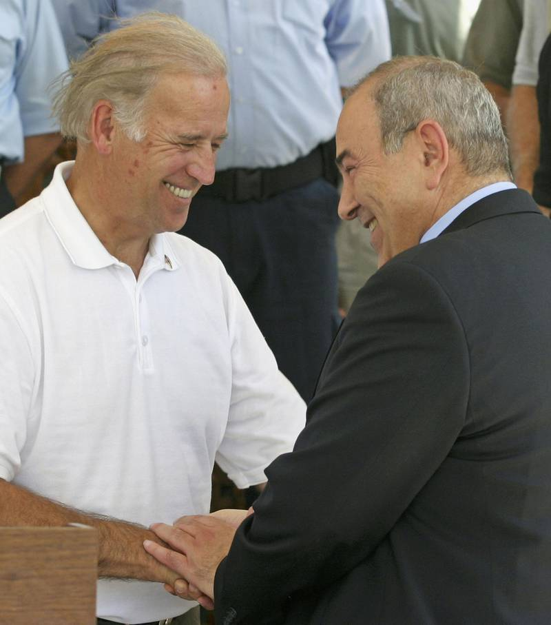 BAGHDAD, IRAQ - JUNE 19:  United States Senator Joseph Biden (L) is greeted by Iraq's interim Prime Minister Iyad Allawi while visiting the capital on June 19, 2004 in Baghdad, Iraq. Bomb attacks continued today as a Portuguese Security Guard was killed near the southern town of Zubayr, as the run-up to the handover of sovereignty looms ever closer on June 30.  (Photo by Ceerwan Aziz-Pool/Getty Images)