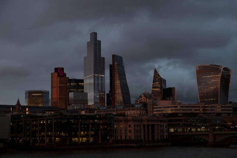 FILE - In this file photo dated Friday, Oct. 23, 2020, the buildings of the City of London stand under a lowering sky, seen from the south bank of the River Thames in London. The Office for National Statistics said Thursday Nov. 12, 2020, that the British economy bounced back strongly in the third quarter of 2020 as many of the restrictions associated with the spring coronavirus lockdown were lifted. (AP Photo/Alastair Grant, FILE)