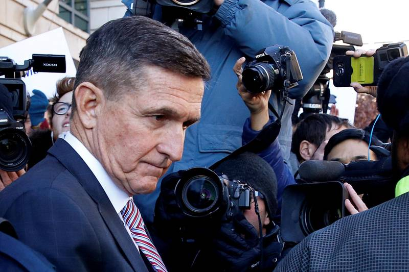 FILE PHOTO: Former U.S. national security adviser Michael Flynn passes by members of the media as he departs after his sentencing was delayed at U.S. District Court in Washington, U.S., December 18, 2018.  REUTERS/Joshua Roberts/File Photo