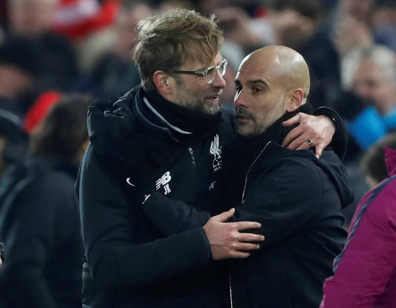 """Soccer Football - Premier League - Liverpool vs Manchester City - Anfield, Liverpool, Britain - January 14, 2018   Liverpool manager Juergen Klopp shakes hands with Manchester City manager Pep Guardiola after the match    Action Images via Reuters/Carl Recine    EDITORIAL USE ONLY. No use with unauthorized audio, video, data, fixture lists, club/league logos or """"live"""" services. Online in-match use limited to 75 images, no video emulation. No use in betting, games or single club/league/player publications.  Please contact your account representative for further details."""