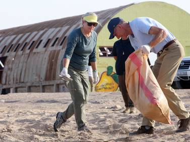 US ambassador to Kuwait helps out on World Cleanup Day - in pictures