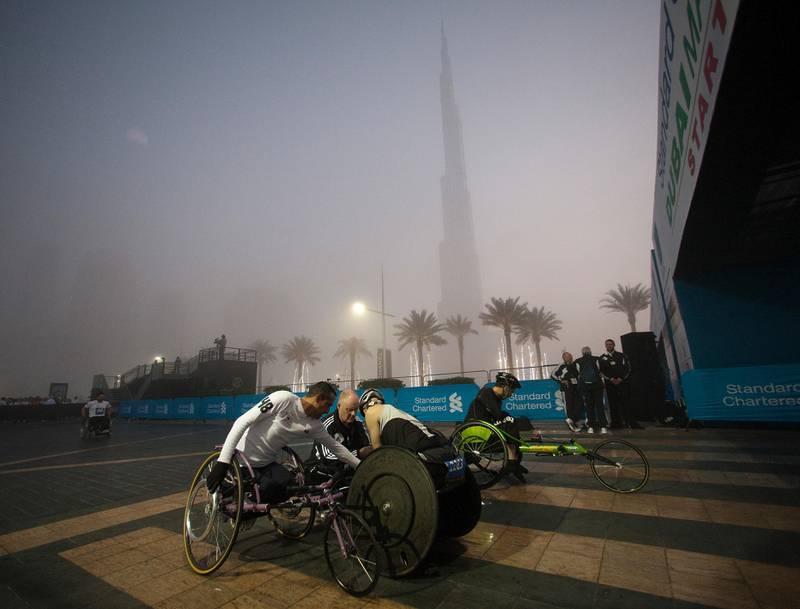 Dubai, United Arab Emirates, Jan 25 2013, 2013 Standard Chartered Dubai Marathon, - Elite wheelchair competitors get ready for the start at the Standard Chartered Dubai Marathon, Jan 25, 2013.  Mike Young / The National