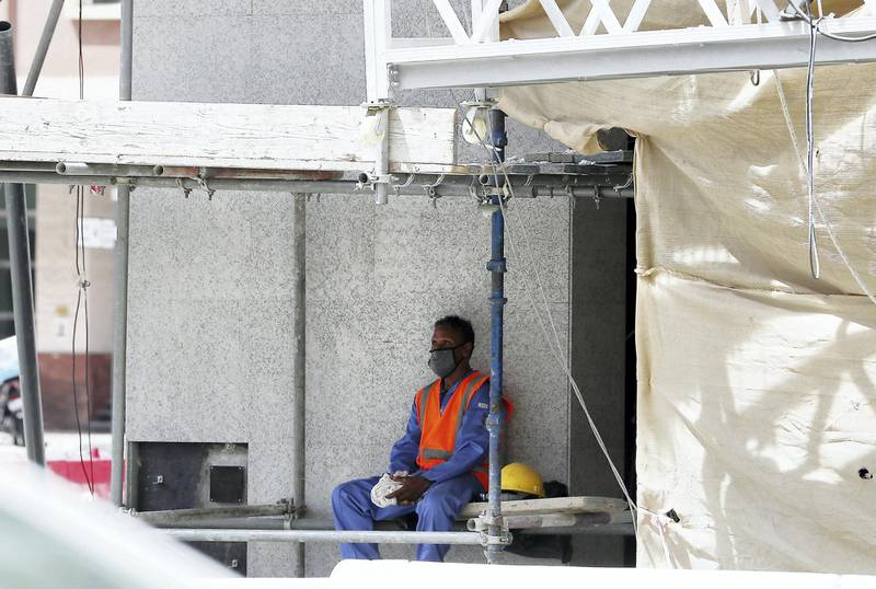 DUBAI, UNITED ARAB EMIRATES , June 15 – 2020 :- Construction worker taking rest during the midday break in Dubai. The UAE's compulsory midday break for outdoor workers started from June 15. (Pawan Singh / The National) For News.