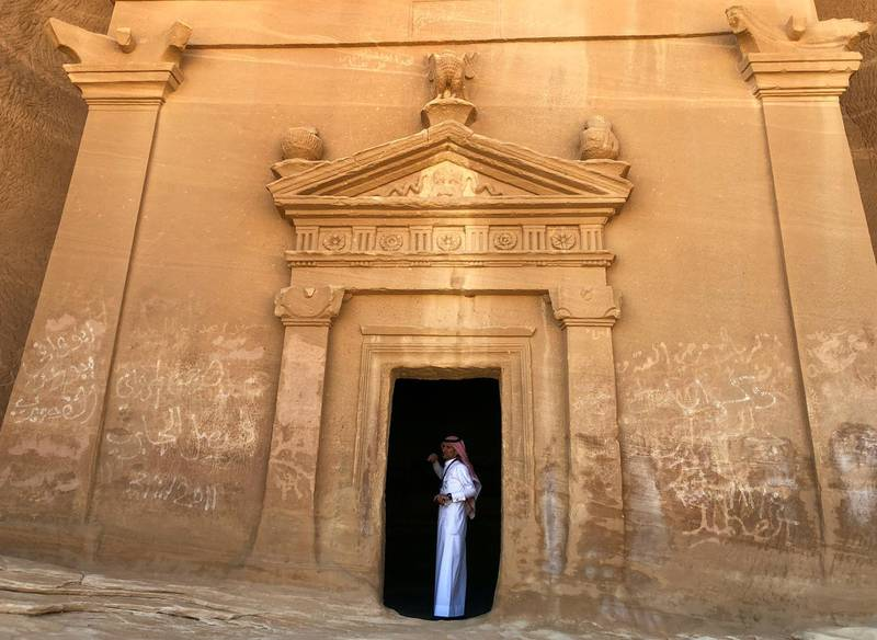 FILE PHOTO: A Saudi tour guide stands inside a tomb at Madain Saleh antiquities site, al-Ula, Saudi Arabia February 10, 2019. Picture taken February 10, 2019. REUTERS/Stephen Kalin/File Photo