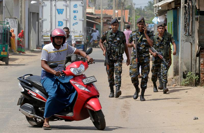 Sri Lankan air force soldiers patrol a Muslim neighborhood following overnight clashes in Poruthota, a village in Negombo, about 35 kilometers North of Colombo, Sri Lanka, Monday, May 6, 2019. Two people have been arrested and an overnight curfew lifted Monday after mobs attacked Muslim-owned shops and some vehicles in a Sri Lankan town where a suicide bombing targeted a Catholic church last month. Residents in the seaside town of Negombo say the mostly-Catholic attackers stoned and vandalized shops. It is unclear how the dispute began but most residents say a private dispute took a religious turn. (AP Photo/Eranga Jayawardena)
