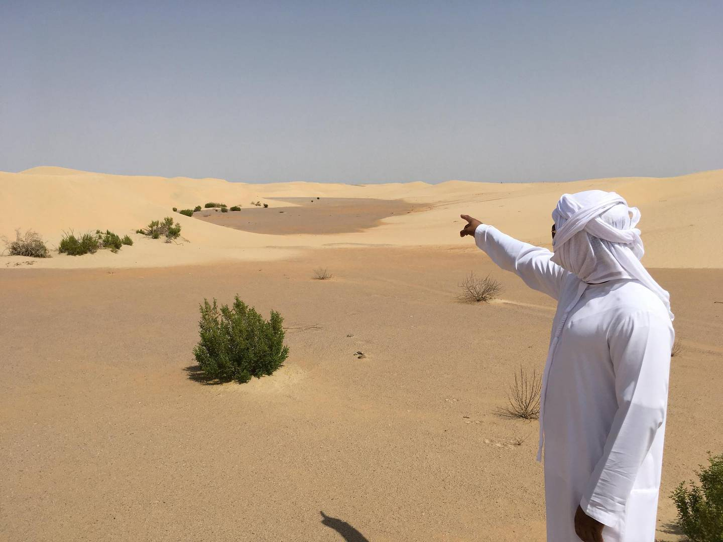 Hosn al Sirra. Omar al Kaabi, from the Department of Culture and Tourism, points the way to Abu Dhabi. Photo credit: Tim Power.