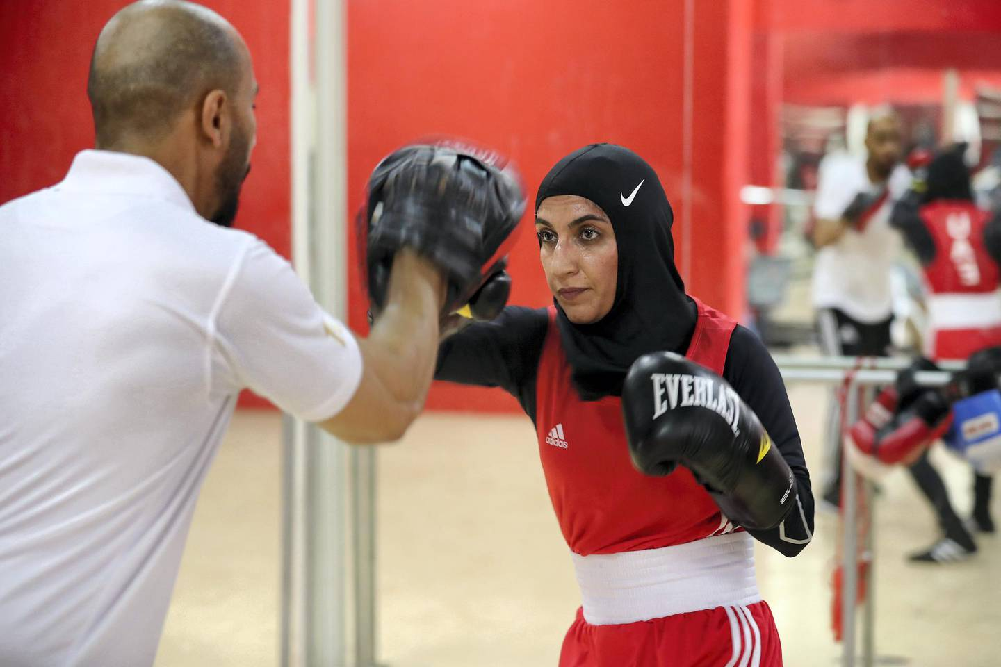 ABU DHABI,  UNITED ARAB EMIRATES , JUNE 16 – 2019 :- Mohammed Al Shebli , National team coach giving boxing training  to Fahima Falaknaz ( right )  at the UAE Boxing Federation HQ located at the Zayed Sports City Football stadium in Abu Dhabi. ( Pawan Singh / The National ) For Sport. Story by Amith