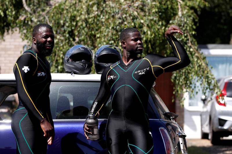 Bobsleigh - Jamaica Bobsleigh team members Shanwayne Stephens and Nimroy Turgott stand beside a Mini Cooper. They have been pushing the car around the streets of Peterborough as part of their training following the outbreak of the coronavirus disease (COVID-19), Peterborough, Britain, May 29, 2020. REUTERS/Paul Childs