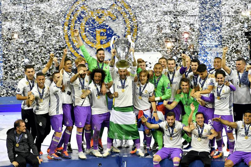 CARDIFF, WALES - JUNE 03:  In this handout image provided by UEFA, Sergio Ramos of Real Madrid lifts The Champions League trophy after the UEFA Champions League Final between Juventus and Real Madrid at National Stadium of Wales on June 3, 2017 in Cardiff, Wales.  (Photo by Handout/UEFA via Getty Images)