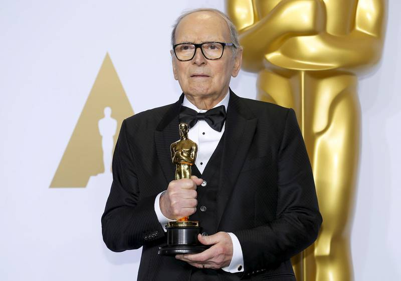 """FILE PHOTO: Italian composer Ennio Morricone poses with his Oscar for Best Original Score for """"The Hateful Eight,"""" during the 88th Academy Awards in Hollywood, California February 28, 2016.  REUTERS/Mike Blake/File Photo"""