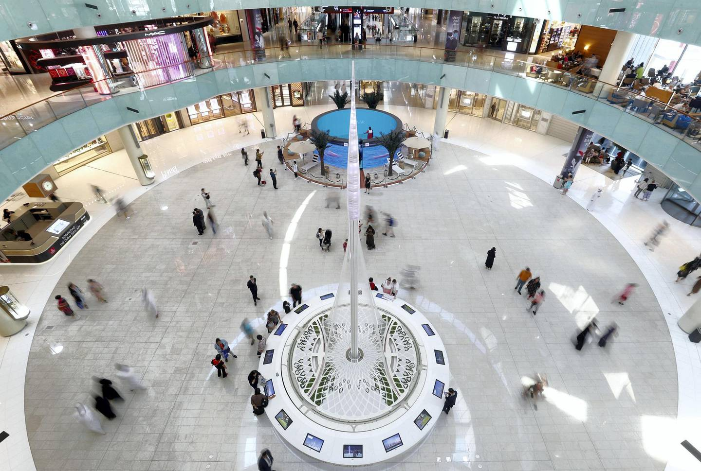 Dubai, United Arab Emirates - September 21, 2019: Standalone. A busy afternoon at Dubai mall as people shop at the weekend in front of the Dubai Creek Tower model. Saturday the 21st of September 2019. Dubai Mall, Dubai. Chris Whiteoak / The National