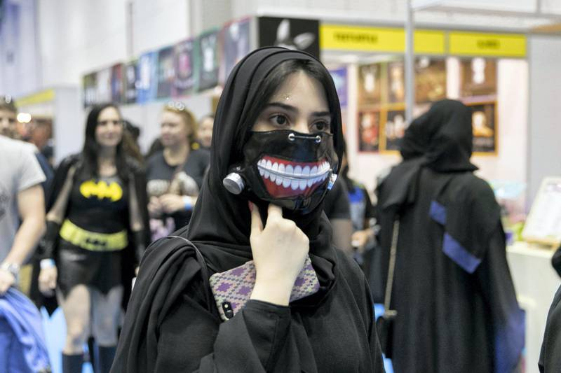 DUBAI, UNITED ARAB EMIRATES - APRIL 7, 2018.  A girl with a mouth mask at Middle East Film and Comic Con.  (Photo by Reem Mohammed/The National)  Reporter: Section: NA