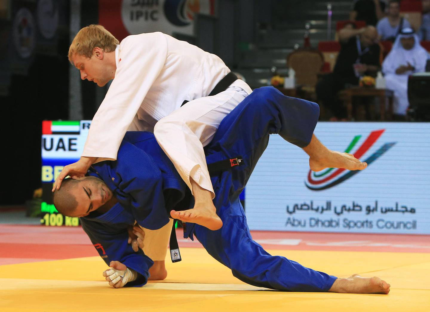 ABU DHABI - UNITED ARAB EMIRATES - 02OCT2014 - UAE's  Ivan Remarenco (in white) and Belgium's Toma Nikiforov fights in quarter- final in -100 kilograms category during Judo Grand Slam, Abu Dhabi 2014, organised International Judo Federation yesterday at FGB Arena at the Zayed Sports City in Abu Dhabi. Ravindranath K / The National (to go with Amith story for Sports)