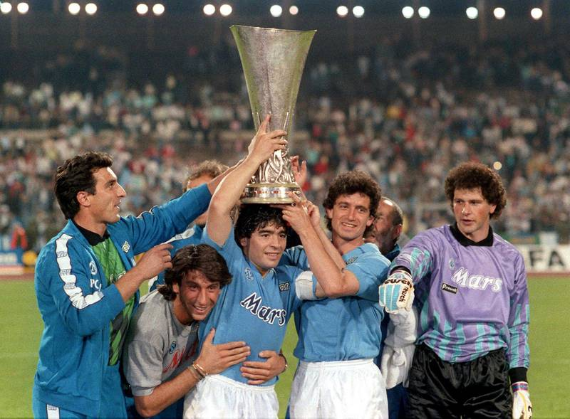 Raffaele Di Fusco,Massimo Crippa, Diego Armando Maradona, Francesco Romano and Giuliano Giuliani of SSC Napoli celebrate his victory with the trophy during the UEFA Cup Final Second Leg match between Stuttgart and Napoli, at Neckarstadion, Stuttgart, Germany on May 17th 1989  (Photo by Alessandro Sabattini/Getty Images)