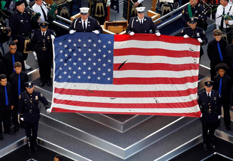 The flag that flew over the World Trade Center on 9/11 is seen during ceremonies marking the 10th anniversary of the 9/11 attacks on the World Trade Center, in New York, September 11, 2011. REUTERS/Mark Blinch (UNITED STATES - Tags: ANNIVERSARY DISASTER TPX IMAGES OF THE DAY) *** Local Caption ***  WTC114_SEPT11-_0911_11.JPG