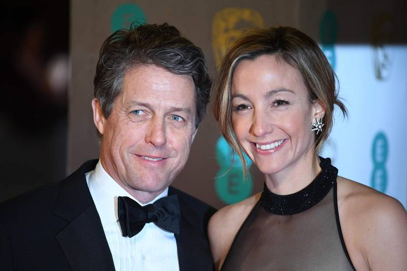 """(FILES) In this file photo taken on February 12, 2017 British actor Hugh Grant (L) and Swedish producer Anna Eberstein (R) pose upon arrival at the BAFTA British Academy Film Awards at the Royal Albert Hall in London on February 12, 2017. Veteran bachelor Hugh Grant, star of a string of romantic comedies including """"Four Weddings and a Funeral"""", is finally getting married for the first time at the age of 57 to his Swedish girlfriend, 39-year-old television producer Anna Eberstein. / AFP / Justin TALLIS"""
