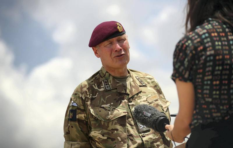British Lieutenant General Sir John Lorimer speaks during an interview with Reuters at Beirut's port, damaged after a blast in Beirut, Lebanon, August 10, 2020. REUTERS/Hannah McKay