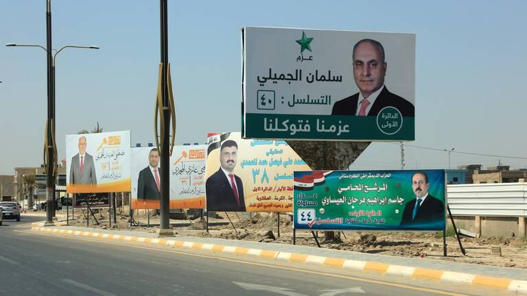 An image that illustrates this article Iraq election: candidates get to work to win over voters