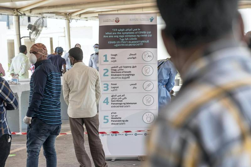 ABU DHABI, UNITED ARAB EMIRATES. 16 APRIL 2020. COVID-19 Testing station in Al Mussafah. Men wait in line for their pre-check ahead of being tested. (Photo: Antonie Robertson/The National) Journalist: Haneen Dajani. Section: National.