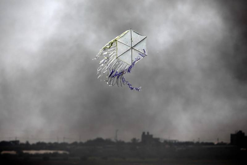 A kite flies over the border in an area where kites and balloons have caused blazes, between Israel and the Gaza strip  June 8, 2018. REUTERS/Amir Cohen