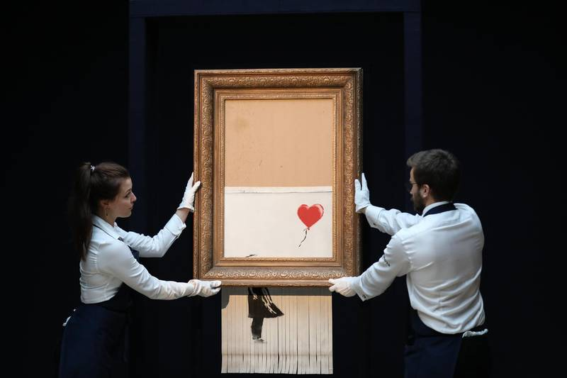 LONDON, ENGLAND - OCTOBER 12: Sotheby's unveils Banksy's newly-titled 'Love is in the Bin' at Sotheby's on October 12, 2018 in London, England. Originally titled 'Girl with Balloon', the canvas passed through a hidden shredder seconds after the hammer fell at Sotheby's London Contemporary Art Evening Sale on October 5, 2018, making it the first artwork in history to have been created live during an auction. (Photo by Tristan Fewings/Getty Images for Sotheby's)