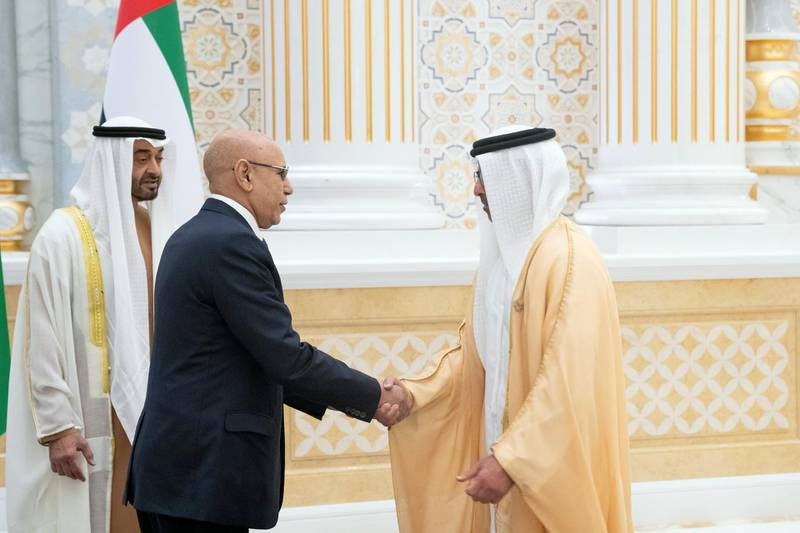ABU DHABI, UNITED ARAB EMIRATES - February 02, 2020: HE Mohamed Ould Ghazouani, President of Mauritania (2nd L) greets HH Sheikh Hamed bin Zayed Al Nahyan, members of Abu Dhabi Executive Council (R), during an official visit reception, at Qasr Al Watan. Seen with HH Sheikh Mohamed bin Zayed Al Nahyan, Crown Prince of Abu Dhabi and Deputy Supreme Commander of the UAE Armed Forces (L).  ( Hamad Al Kaabi / Ministry of Presidential Affairs ) ---