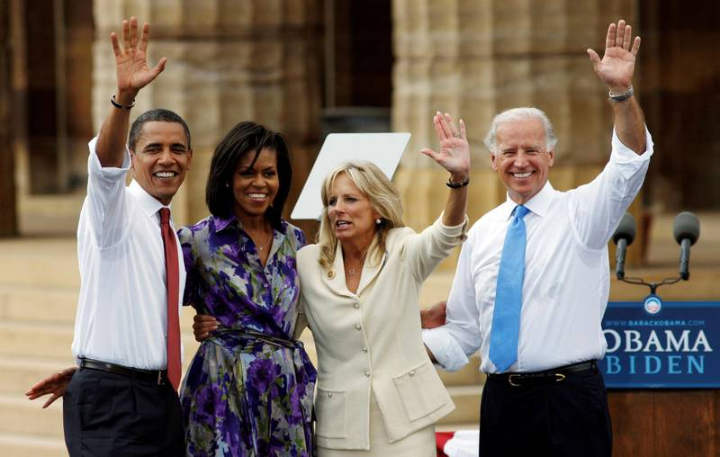 FILE PHOTO: US Democratic presidential candidate Senator Barack Obama (D-IL) (L) and his wife Michelle wave together with Obama's vice presidential running mate Senator Joe Biden (D-DE) (R) and his wife Jill during a campaign event at the Old State Capitol in Springfield, Illinois, U.S., August 23, 2008. REUTERS/John Gress/File Photo