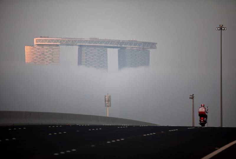 Abu Dhabi, United Arab Emirates, January 28, 2013:  As in the rest of the city, a thick fog moved across the Abu Dhabi's Reem Island on Monday evening, Jan. 28, 2013. Silvia Razgova / The National