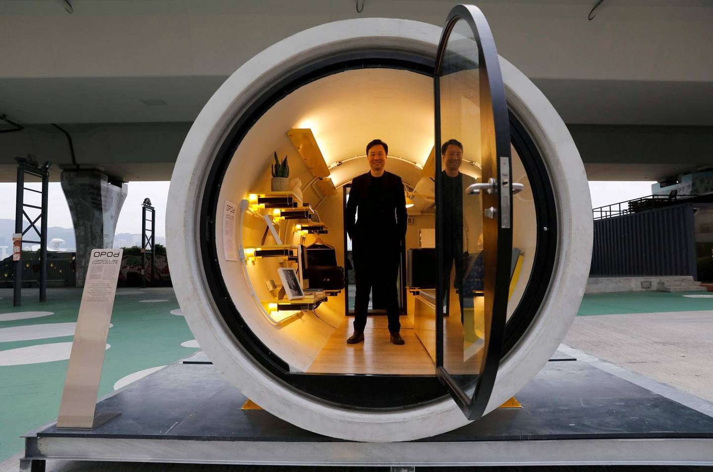 """Architect James Law poses inside of his work, """"Opod"""", a 120-square-ft giant water pipes, designed as micro-housing in Hong Kong, China December 14, 2017. Picture taken on December 14, 2017. REUTERS/Tyrone Siu - RC120FE72920"""