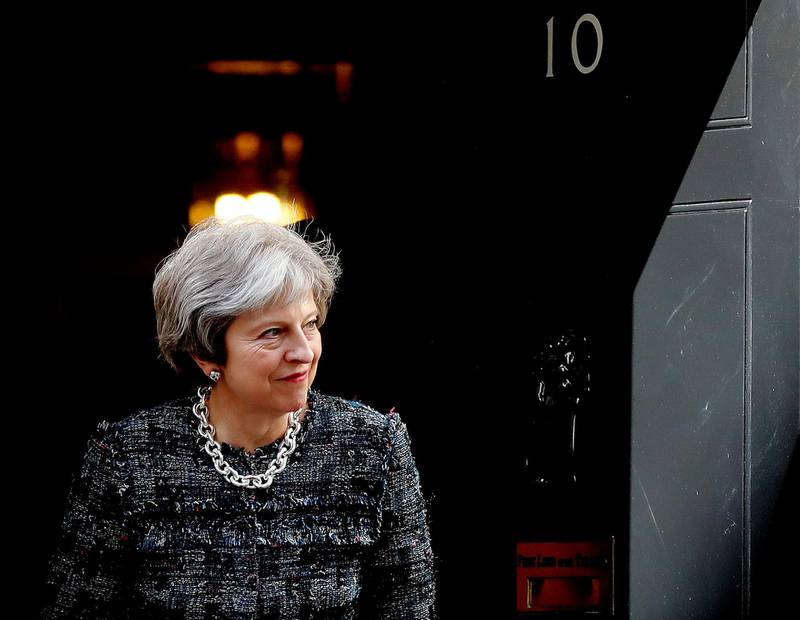 Britain's Prime Minister Theresa May leaves 10 Downing Street to meet President Ilham Aliyev of Azerbaijan for bilateral talks in London, Thursday, April 26, 2018. (AP Photo/Frank Augstein)