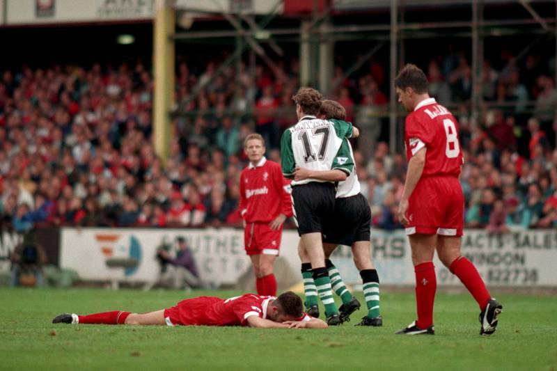 Swindon Town players can only look dejected as Steve McManaman celebrates Liverpool's fifth goal with scorer Ronnie Whelan  (Photo by Ross Kinnaird - PA Images via Getty Images)