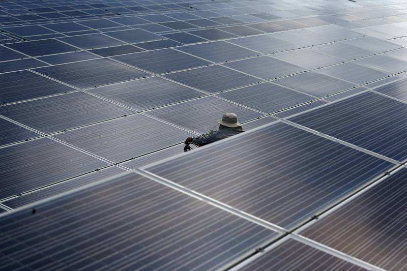 A worker works at a solar power plant by Superblock, Southeast Asia's biggest producer of solar power in Phetchaburi province, Thailand, August 23, 2017. REUTERS/Athit Perawongmetha     TPX IMAGES OF THE DAY