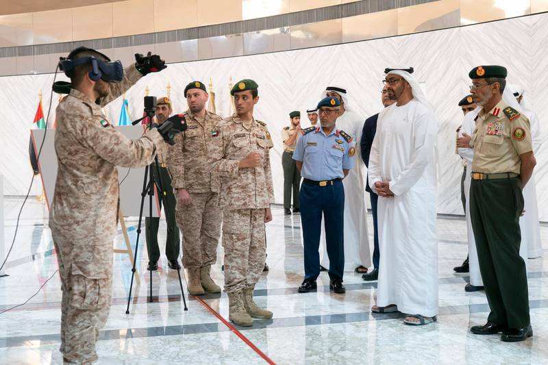 ABU DHABI, UNITED ARAB EMIRATES - April 28, 2019: HH Sheikh Mohamed bin Zayed Al Nahyan, Crown Prince of Abu Dhabi and Deputy Supreme Commander of the UAE Armed Forces (2nd R), attends e-skills exhibition for national service recruits, at Armed Forces Officers Club. Seen with HE Lt General Hamad Thani Al Romaithi, Chief of Staff UAE Armed Forces (R) and HE Major General Essa Saif Al Mazrouei, Deputy Chief of Staff of the UAE Armed Forces (3rd R). ( Rashed Al Mansoori / Ministry of Presidential Affairs ) ---
